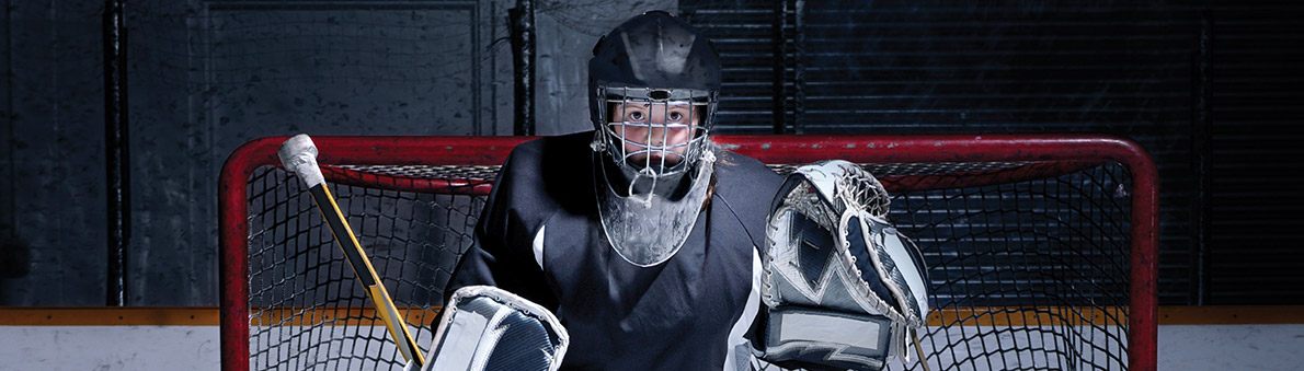 Hockey goalie with heavy padding, representing the protection Collaborative Divorce professional provide for couples who prefer divorce without court.