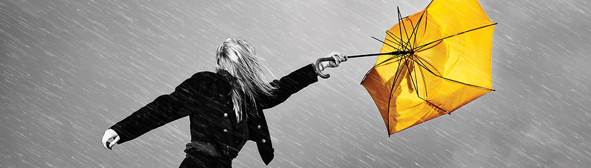 Out of control umbrella, representing why many couples prefer a Collaborative Divorce, the best way to get help with separation or divorce or to pursue a cheap divorce in Edmonton, Alberta.