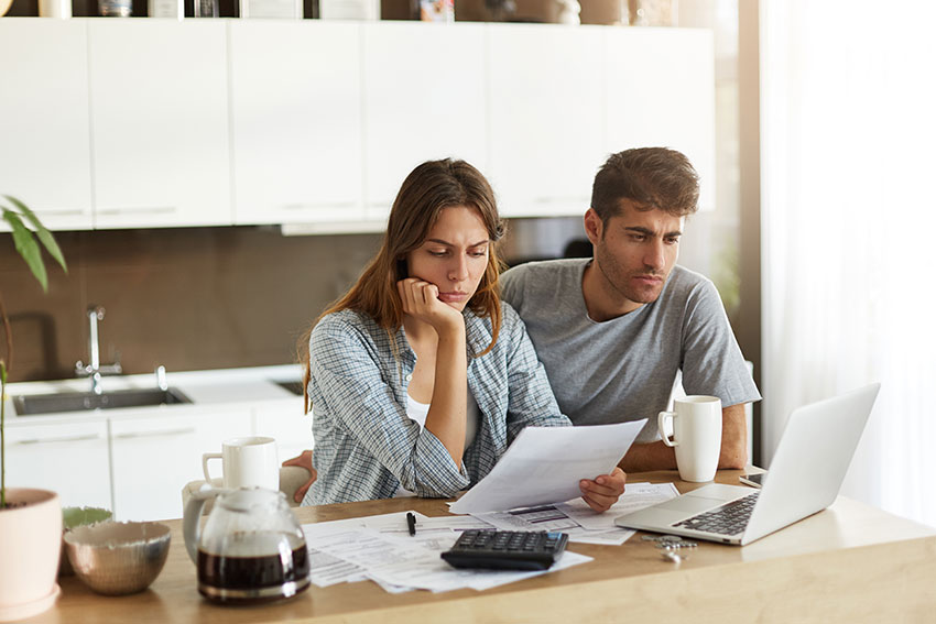 photo of a divorcing couple preparing their financial documents to disclose to their collaborative divorce lawyer to speed up their divorce